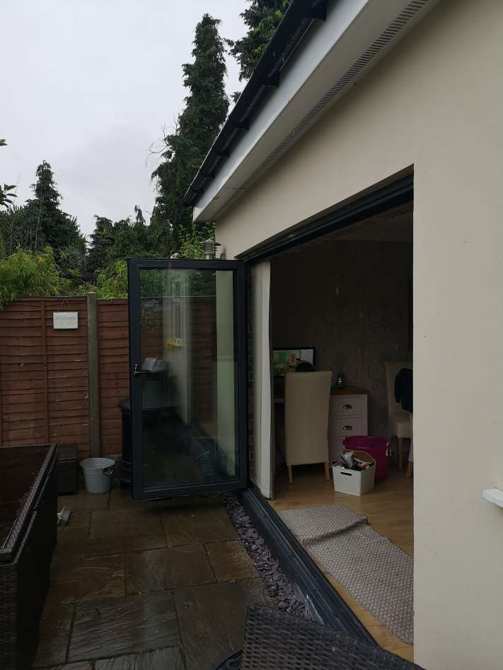 Bifold door realignment
